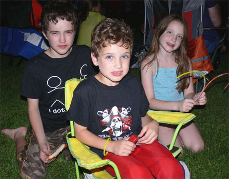 Ready for the nighttime sky to be lit up are the Scali siblings of Shelton, from left, Gavin, 11; Colin, 6; and Maura, 9. (Photo by Brad Durrell)