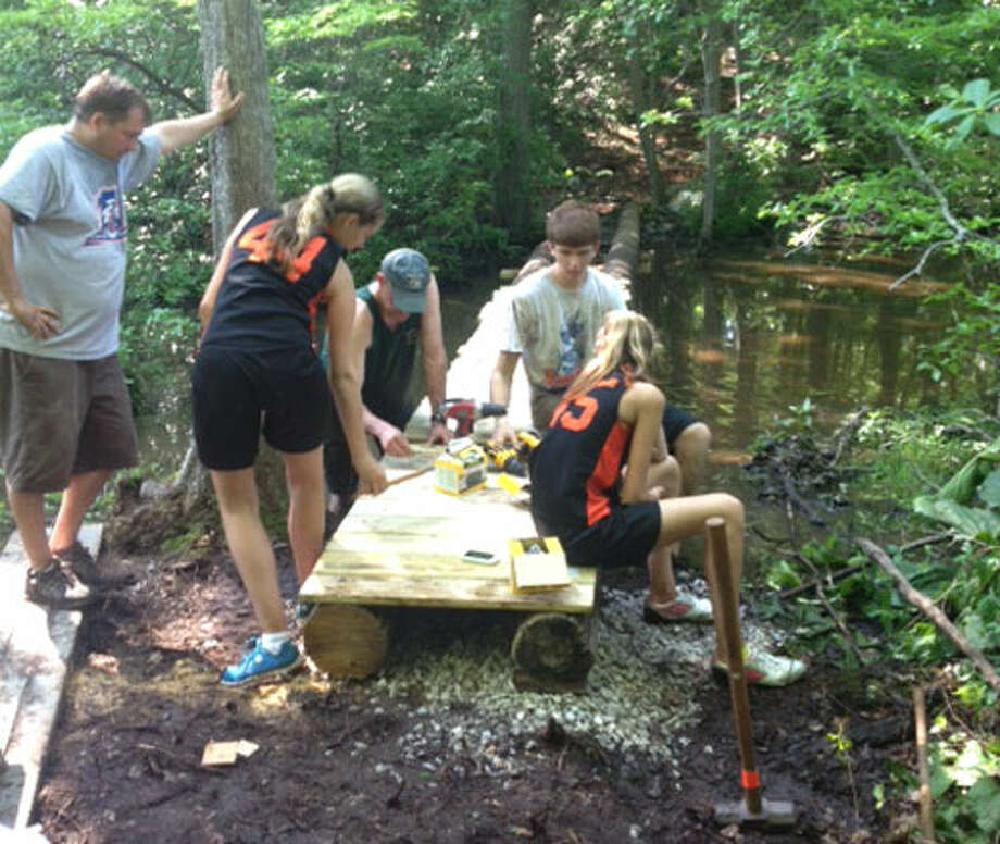 Shelton Boy Scout Josh Kreitler and friends work on building a boardwalk on the Paugussett Trail as part of his Eagle Scout project.
