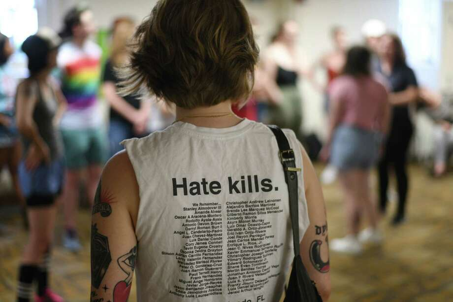 On Sunday, June 2, 2019, Organizer Mary Quintero-Wright wears a shirt with the names of the victims of the Orlando, Florida, Pulse night club shooting in 2016 while watching marshal training for this year's Dyke in Washington. The march is scheduled for Friday. Photo: Photo For The Washington Post By Astrid Riecken. / Astrid Riecken