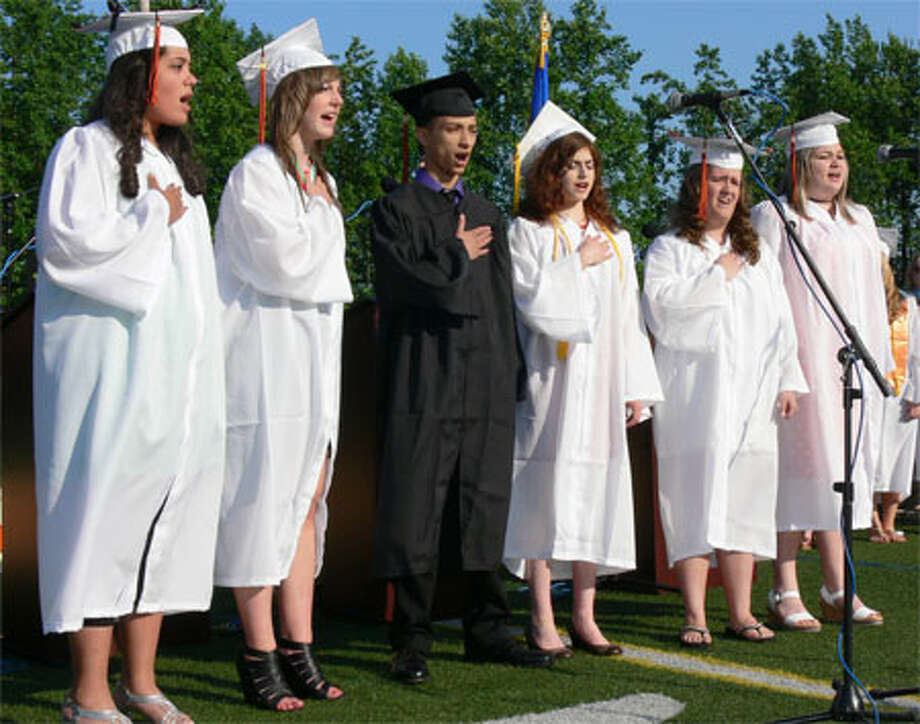 Shelton High seniors in the concert choir perform the National Anthem at graduation.