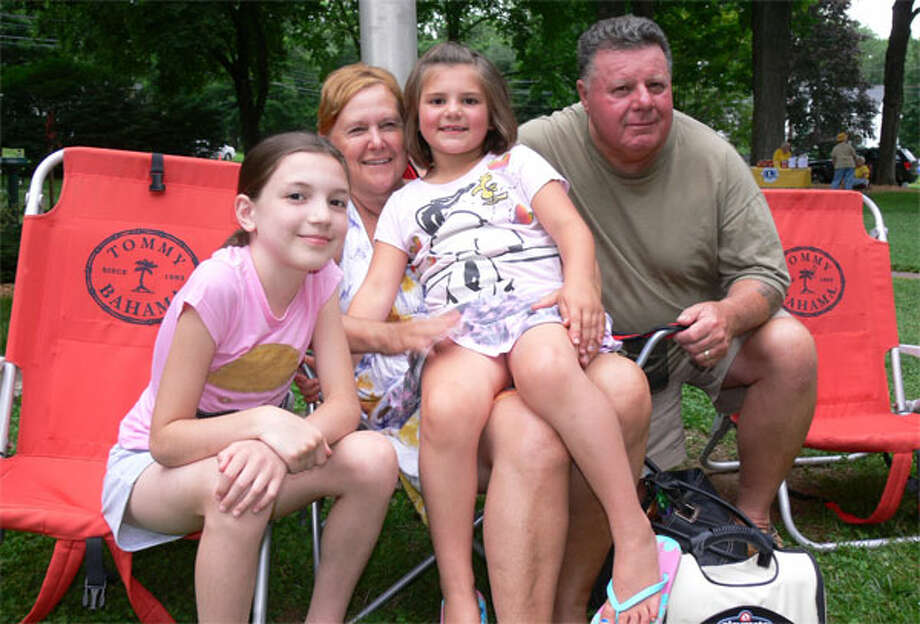 Getting ready for the initial concert on the green this summer are Janet and Nemetz with granddaughters, from left, Cora Welsh, 11, and Ella Welsh, 6, all of Shelton.