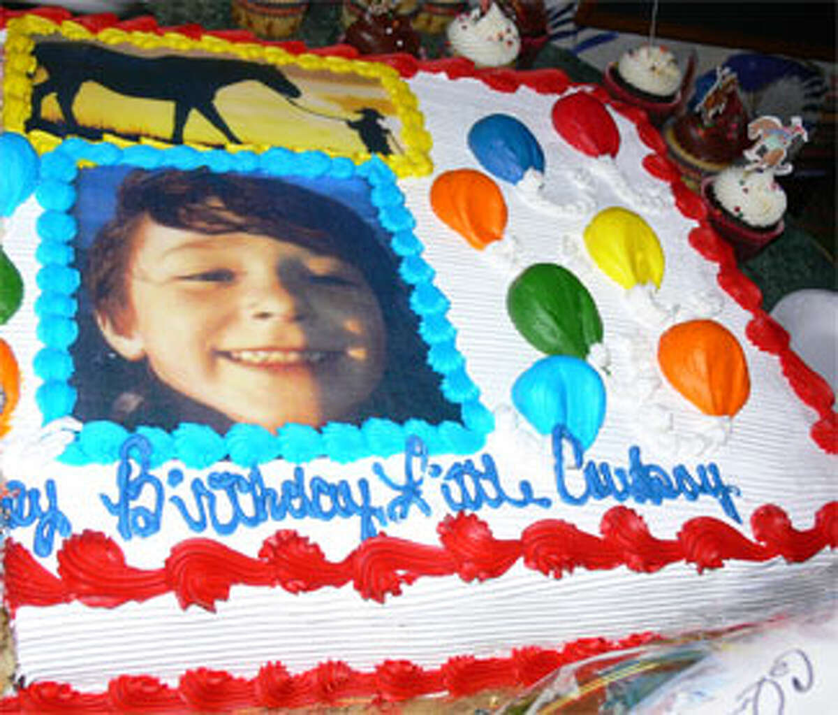A birthday cake for the late Jesse Lewis at the 2013 SHS '81 fund-raising event with the message,