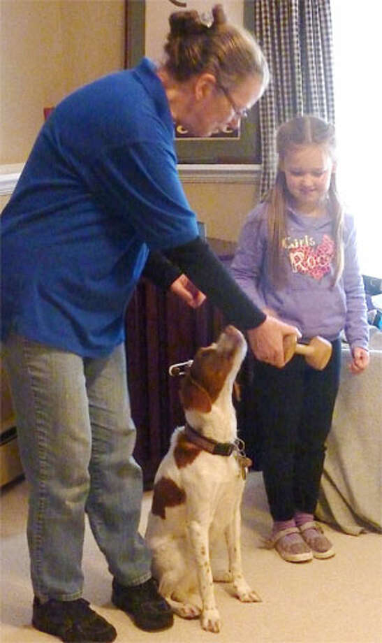 Dona Campbell with a young helper at a Trap Falls Kennel Club's Doggie Safety Education Program for a Weston Brownie troop.