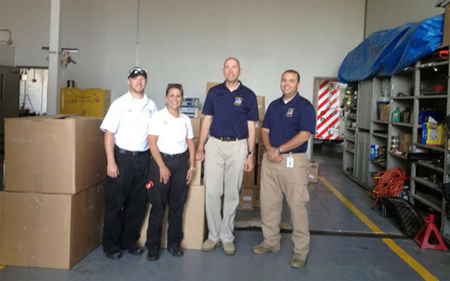 On the right, Shelton Echo Hose Ambulance volunteers Tim Greer and Jeff Caporaso with Oklahoma EMS personnel and post-tornado supplies at the Sugar Creek EMS in Oklahoma. (Photo provided by Twitter@EMT_IN_CT)