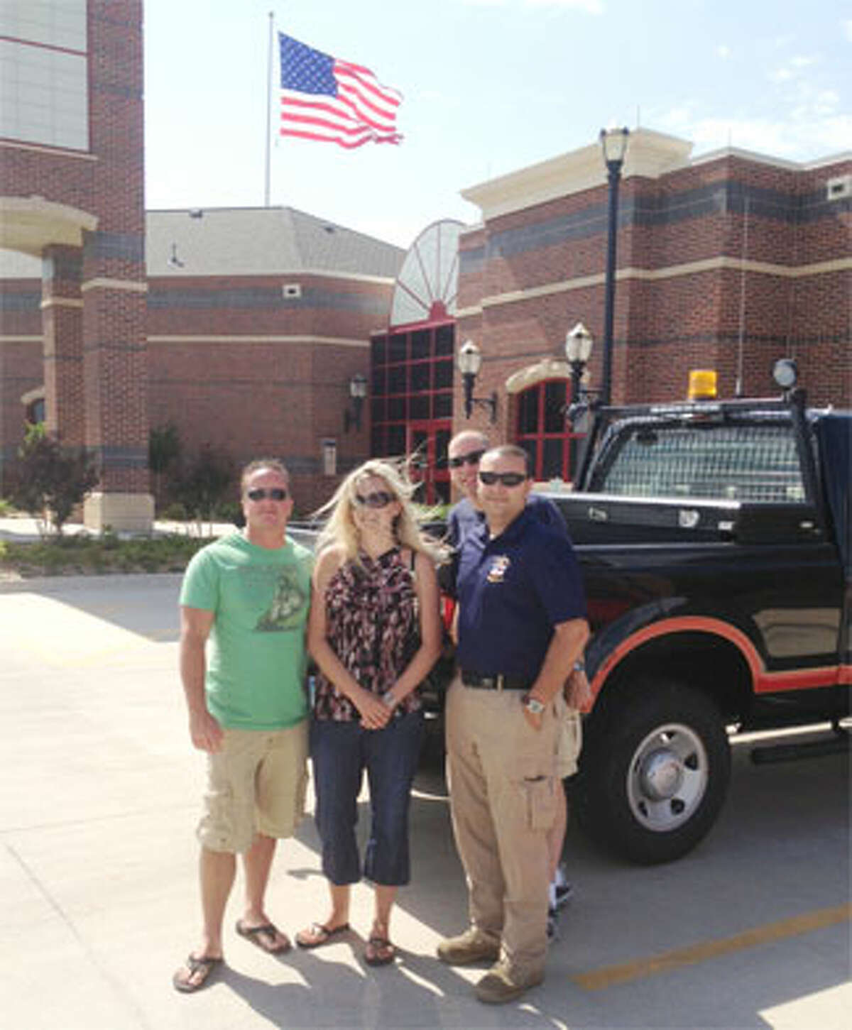 Standing outside the Moore (Okla.) Fire Department are, from left, Moore firefighter Wayne Hamett, Jennifer Hamett, and Echo Hose Ambulance representatives Tim Greer and Jeff Caporaso. (Photo provided by Twitter@EMT_IN_CT)