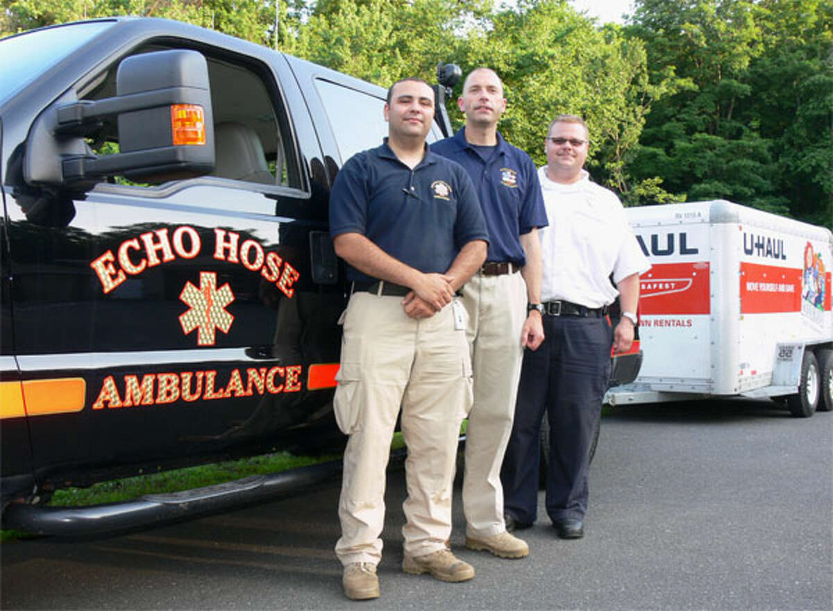 Echo Hose Ambulance Volunteer Corps members Jeff Caporaso, left, and Tim Greer, center, with Chief Mike Chaffee before they begin a three-day mission to assist tornado first responders and victims in Oklahoma.