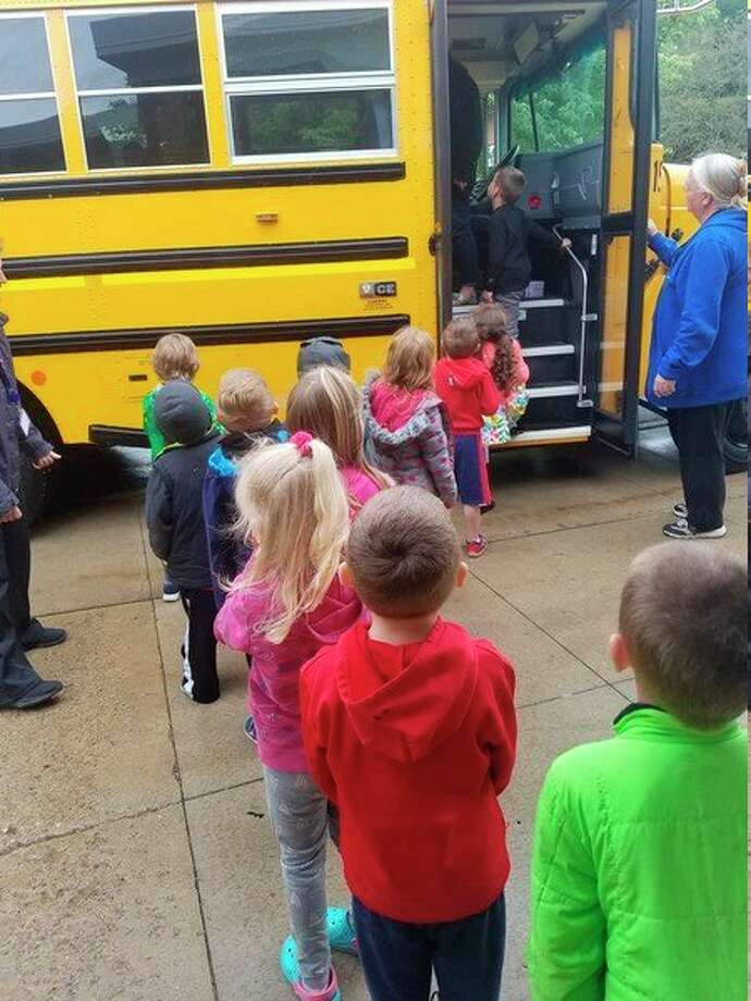 NEMCSA's Midland 4 Head Start/GSRP classroom boards a bus recently to go on a field trip to Central Park Elementary. While there, they will get to visit a kindergarten classroom and tour the school. It's one of many activities that are planned each school year to help the preschoolers make a smooth transition from preschool into kindergarten. (Photo provided)
