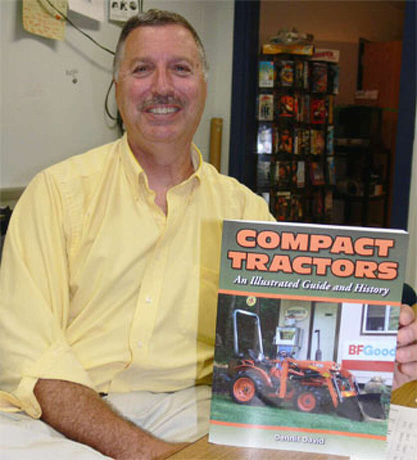 Dennis David, a technology teacher at Shelton Intermediate School, has written a new book about compact tractors.
