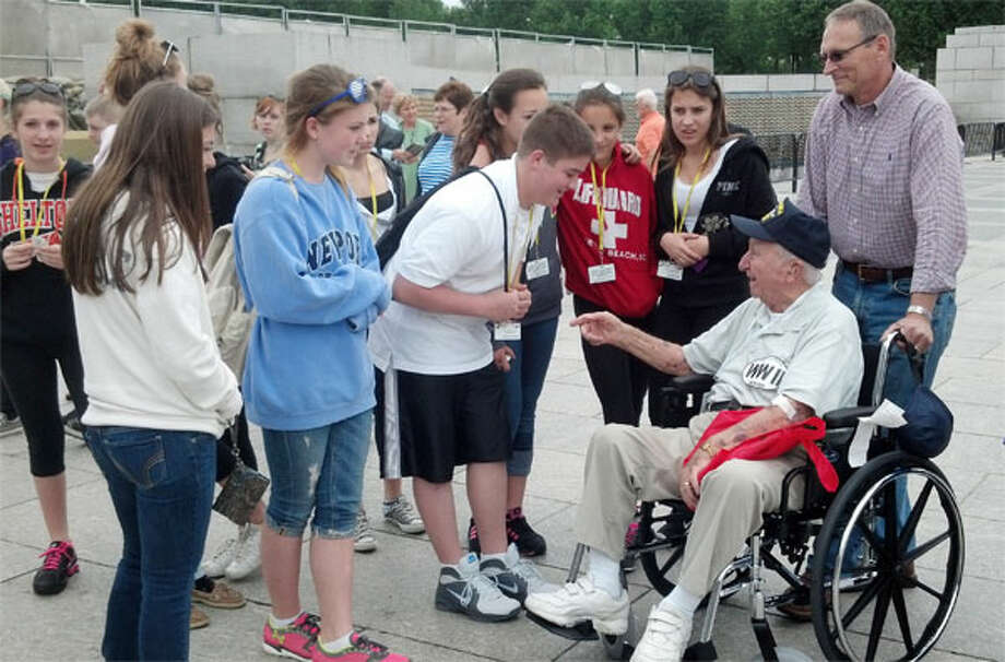 A group of Shelton Intermediate School students thank a veteran for his service at the World War II Memorial while on a field trip to Washington, D.C.