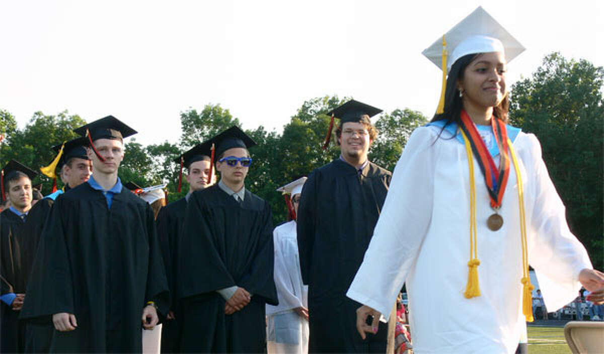 A scene from the 2013 graduation ceremony at Shelton High School.