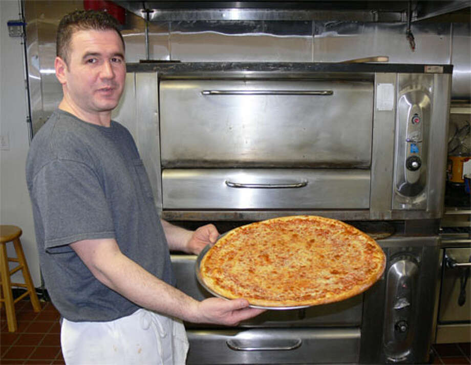 "Agni ""Johnny"" Kalici has opened Downtown Pizza in the same location where he previously operated Johnny's Pizza."