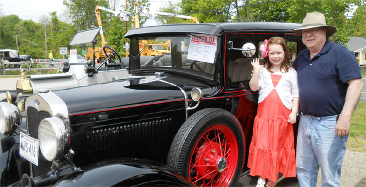 Bill Mohyde, of Shelton, with his granddaughter Molly Mohyde, 7, in front of his 1930 Model A, four-door Town Sedan at the third annual Old Car Meet in 2013 at Beardsley's Cider Mill in Shelton. (Photo by Karen Kovacs Dydzuhn)