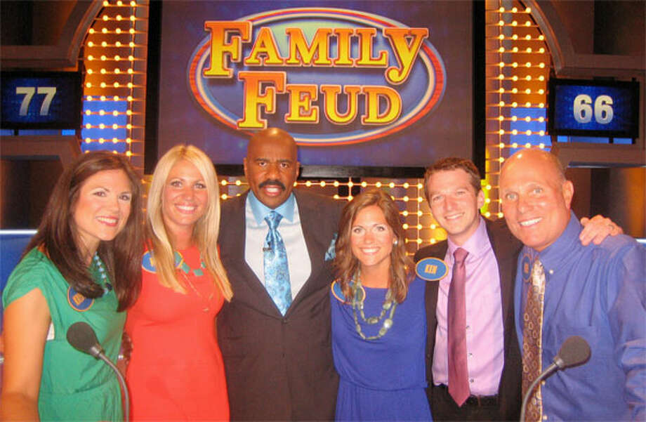 """With """"Family Feud"""" host Steve Harvey (third from left) are members of the Baldyga family of Shelton, from left, Kristen, her sister Kellie, her sister Kim, her husband Ken, and her father Ken."""