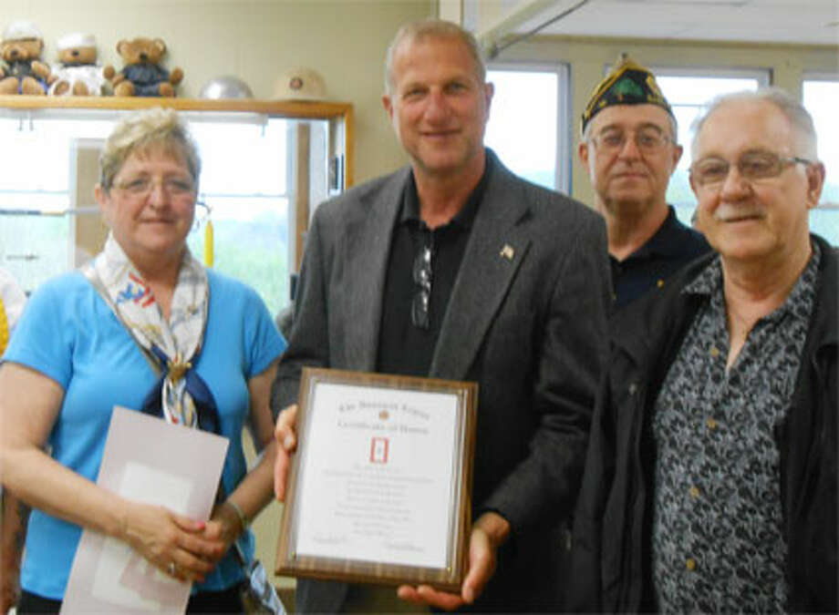 Dolores Kalakay, left, and her husband Joseph, right, attend the Blue Star ceremony on behalf of their grandson Timothy James Adams Jr. They are being congratulated by Mayor Mark Lauretti, second from left, and American Legion Sutter-Terlizzi Post 16 Commander Dave Gallagher Dave Gallagher during the Shelton ceremony. (Photo by Karen Kovacs Dydzuhn)