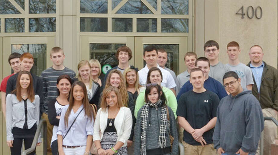 Twenty-two junior and senior students from Shelton High School receive a first-hand look at the judicial system during a tour of the Waterbury courthouse. With them are their teachers Nancy Duffy (back row, third from left) and Fred Mulholland (back row, far right).