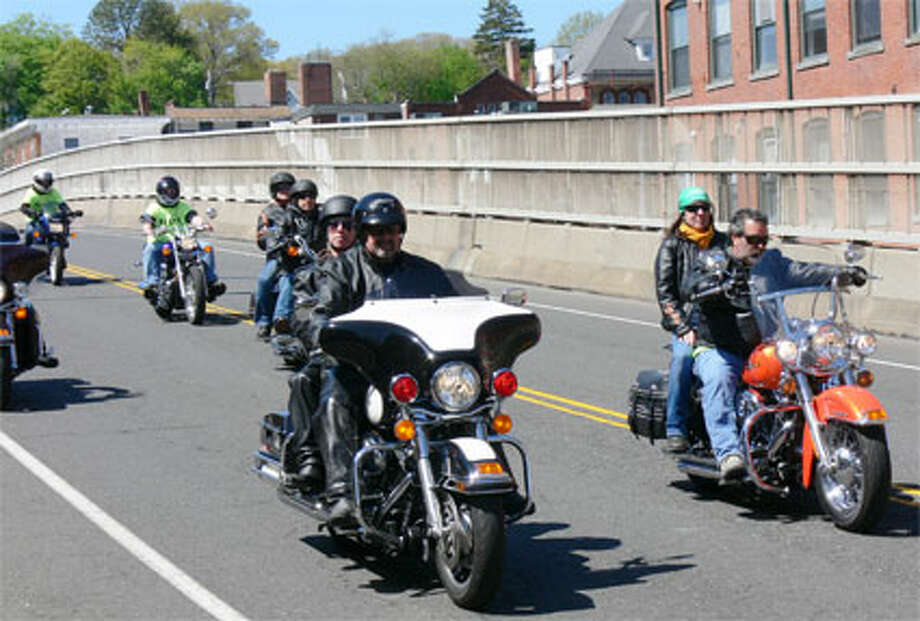 Motorcyclists in the Green Ribbon Ride travel on Bridge Street in Shelton, with the Birmingham condominium complex in the background. (Photo by Brad Durrell)