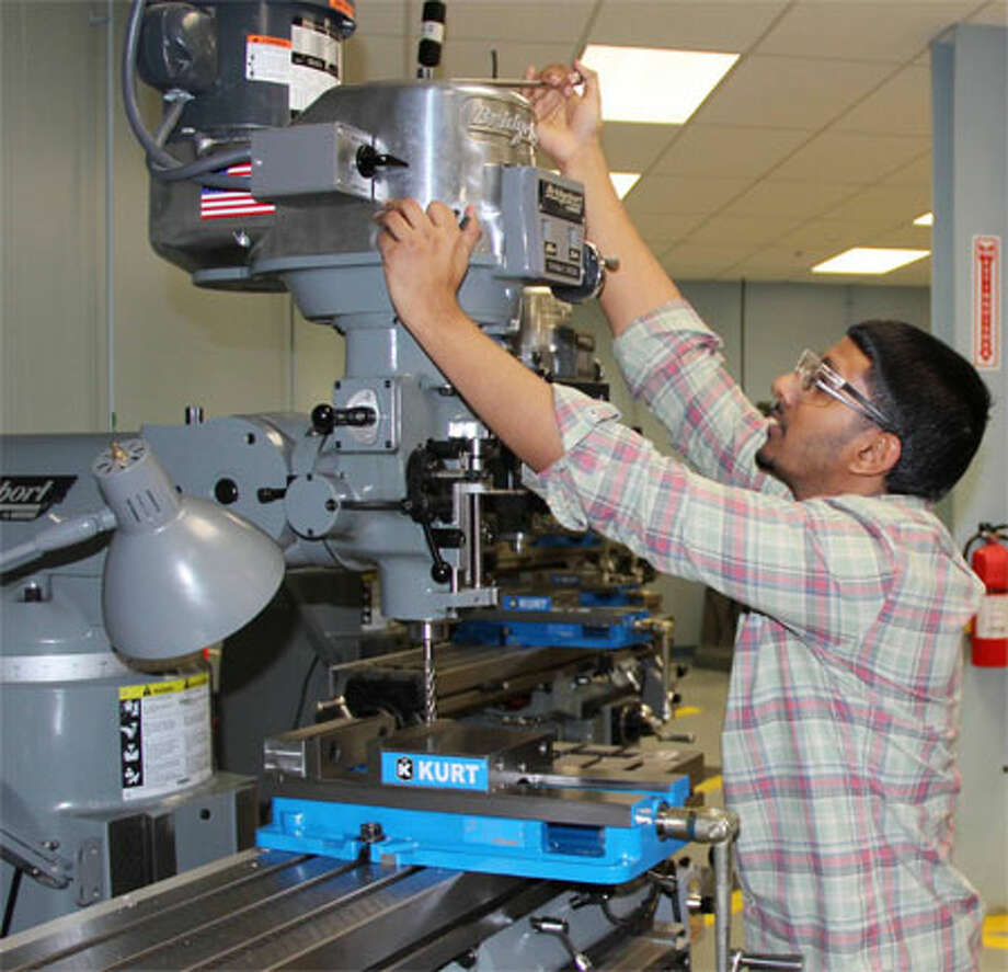Student Irshad Azeez prepares for a high-tech manufacturing career in a class at Housatonic Community College.