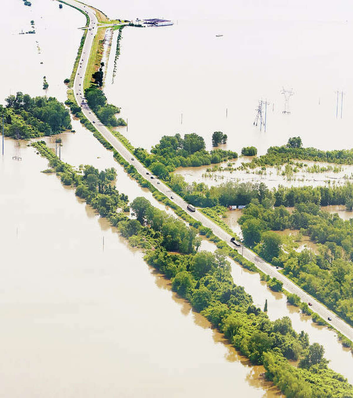 The ways in and out of Alton are getting slimmer by the day. A view of U.S. 67 in West Alton, Missouri, looking north toward the Phillips 66 gas station, upper right, and the Calrk Bridge, show the roadway is quite isolated by floodwaters. Lower U.S. 67 is completely under water.