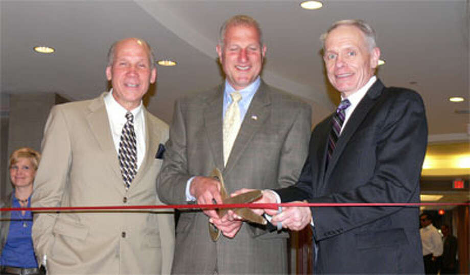 From left, Greater Valley Chamber President Bill Purcell, Mayor Mark Lauretti and Wedge Hotels Corp. President and CEO Brian Stage during the ribbon cutting.