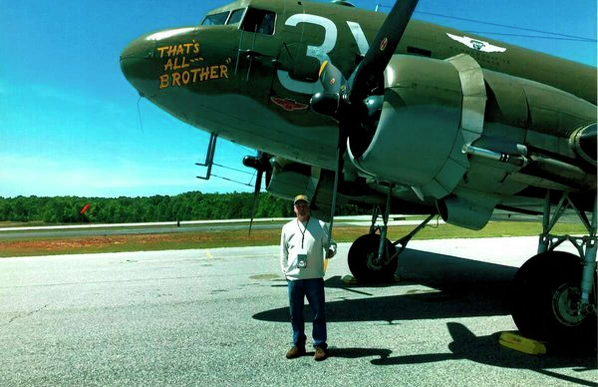 Chip Nelson stands by the plane 'That's All Brother' at the World War II Heritage Days in Georgiaon April 26. Victor Nelson, Chip's dad, was the eighth paratrooper to jump from this plane at 12:44a.m.June 6, 1944, over Normandy, France. (Photo provided)