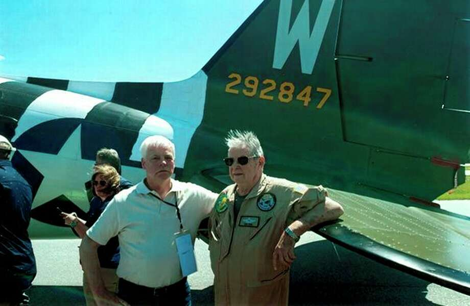 Chip Nelson, left, stands by the plane 'That's All Brother' with the serial numbers visible. Matt Scales, a member of the Alabama Air National Guard in Birmingham, found the plane in a junk yard in Oshkosh, Wisconsin, in 2007 because the serial numbers were still on the plane.