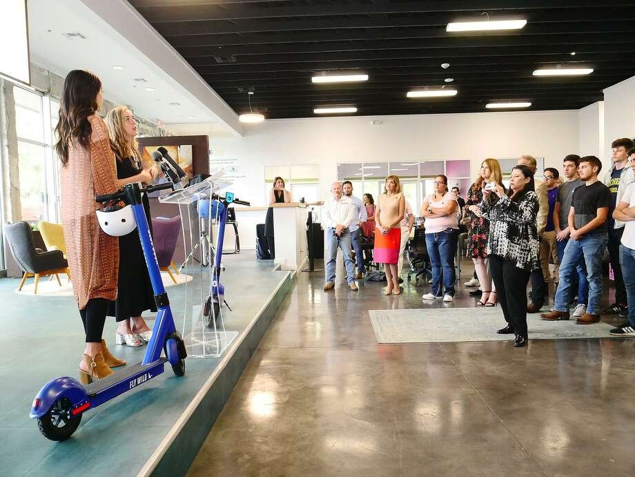Magda González and Elizabeth Lyons Houston, representatives of Blue Duck Scooters, address the audience to provide information about their company during a press conference with city officials to announce their partnership as part of the pilot program that will bring scooters to the two Laredos at a press conference, on Wednesday, June 5, 2019, at the MileOne offices. Photo: Cuate Santos /Laredo Morning Times / Laredo Morning Times