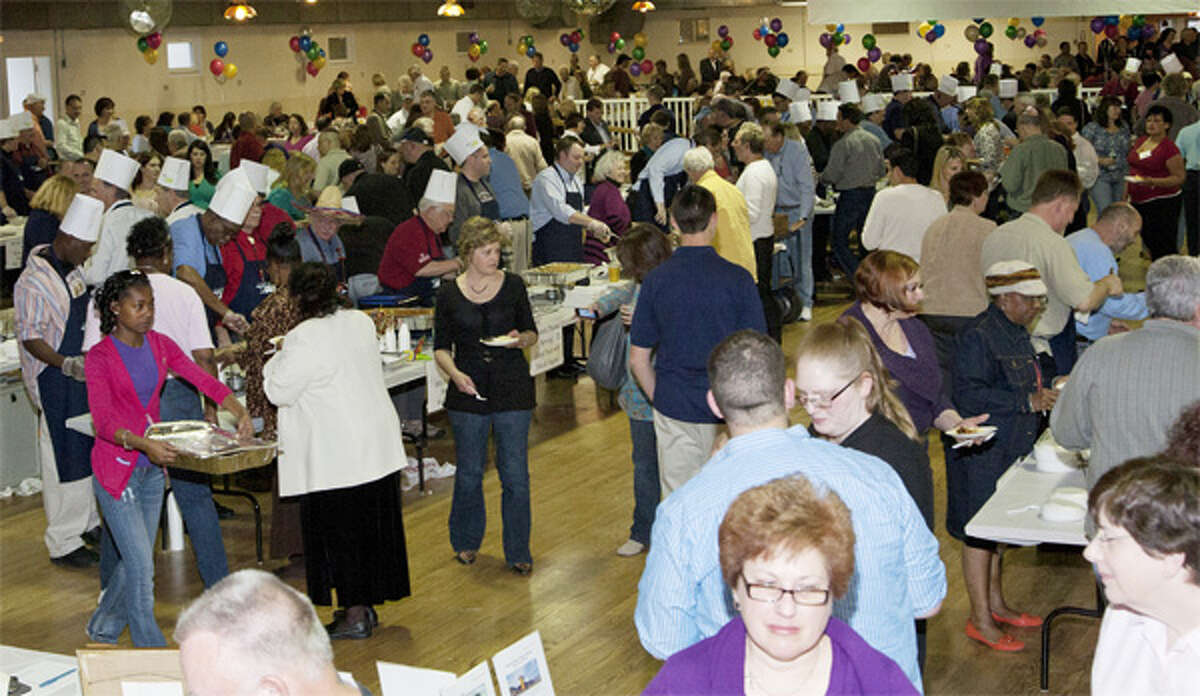 Attendees get to sample many different kinds of cuisine at the annual fund-raising event.