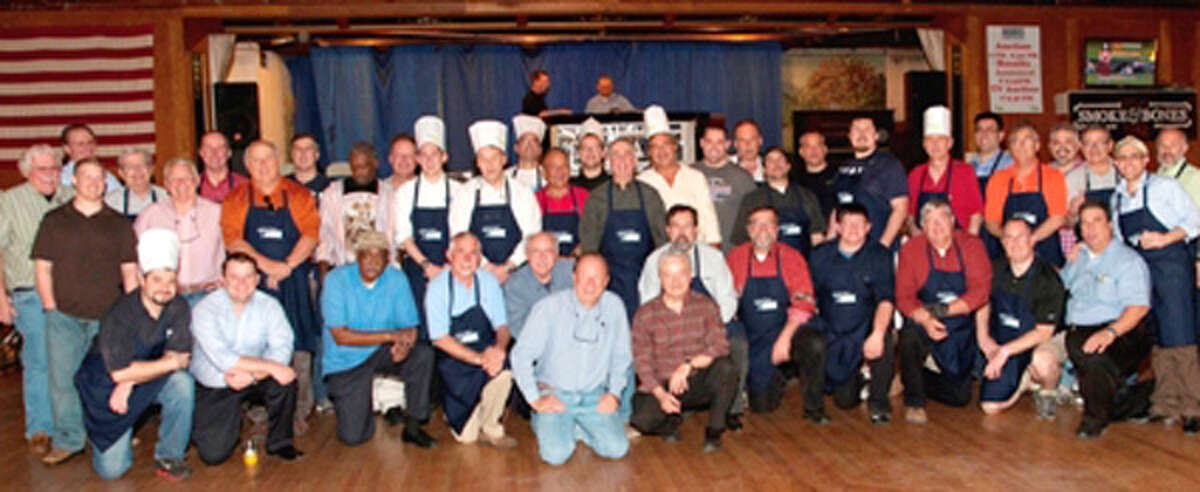 """Participating community chefs from a past TEAM """"Men Who Cook"""" event."""