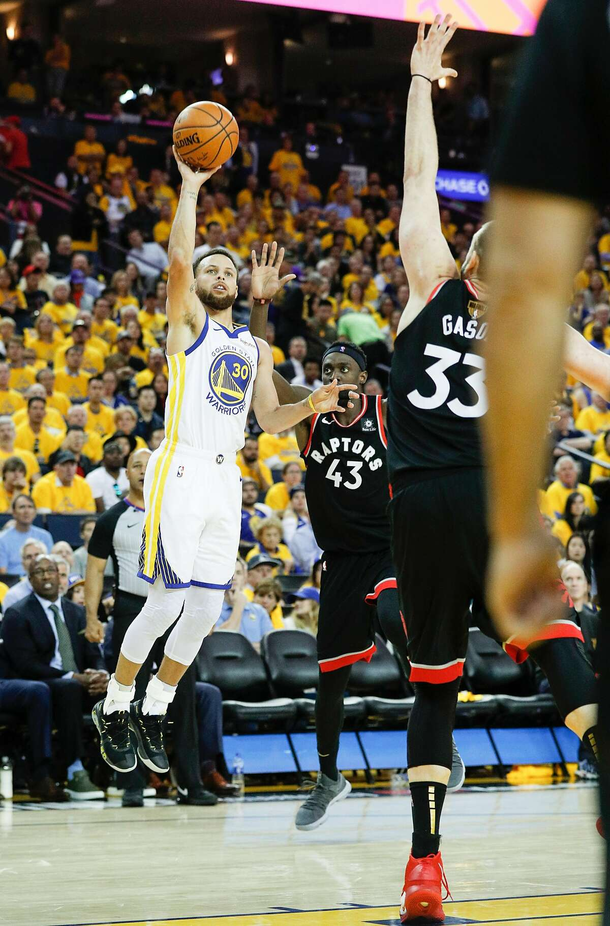 Golden State Warriors' Stephen Curry shoots over Toronto Raptors' Marc Gasol in the third quarter during game 3 of the NBA Finals between the Golden State Warriors and the Toronto Raptors at Oracle Arena on Wednesday, June 5, 2019 in Oakland, Calif.