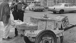 """From the Jan. 30, 1969, Houston Chronicle: Ben W. (Red) Andrews, 67, who has pushed his hand cart through the Washington Avenue area for decades, was shot and critically wounded early today by two young men who robbed him as he stood at the corner of Hemphill and Summer, hawking his ice cream bars.  He was felled by three bullets in the chest, and was in Ben Taub General Hospital.  Captain Leon Colley said the bandits """" """"couldn't have gotten more than pocket change.""""         Known to the kids as """"Ice Cream Red,"""" Andrews sold the treat around Washington Avenue, Houston Avenue, Crockett and """"the little pockets of poverty along White Oak Bayou,"""" the Chronicle wrote. Andrews died of complications on March 1, 1969. A 19-year-old was sentenced to 75 years in the slaying. Two other youths were charged."""