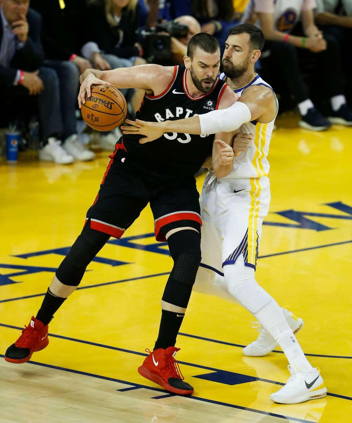 Golden State Warriors' Andrew Bogut guards Toronto Raptors' Marc Gasol in the first quarter during game 3 of the NBA Finals between the Golden State Warriors and the Toronto Raptors at Oracle Arena on Wednesday, June 5, 2019 in Oakland, Calif.