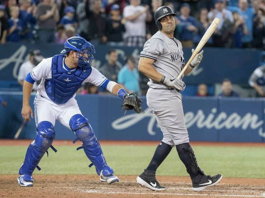 New York Yankees' Kendrys Morales strikes out to end the team's baseball game against the Blue Jays in Toronto on Wednesday, June 5, 2019. (Fred Thornhill/The Canadian Press via AP)