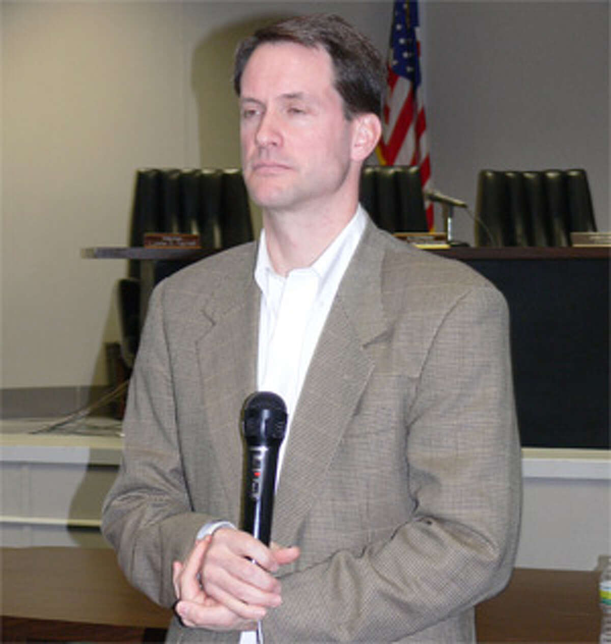 Congressman Jim Himes listens to a constituent speak at the town meeting in Shelton.