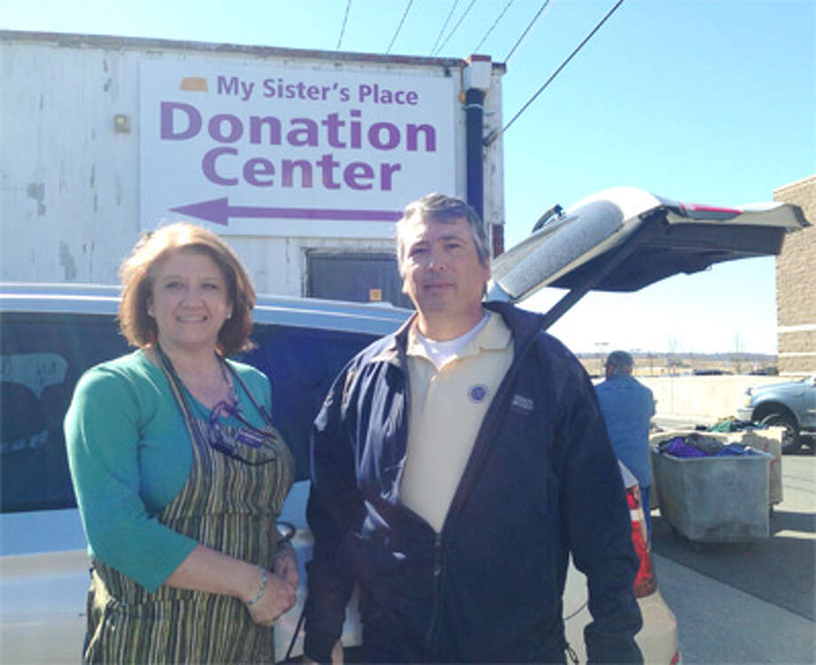 Shelton Exchange Club member Tom Christiano drops off donations for My Sister's Place with the help of Christine Boulay, the thrift store's donations coordinator.