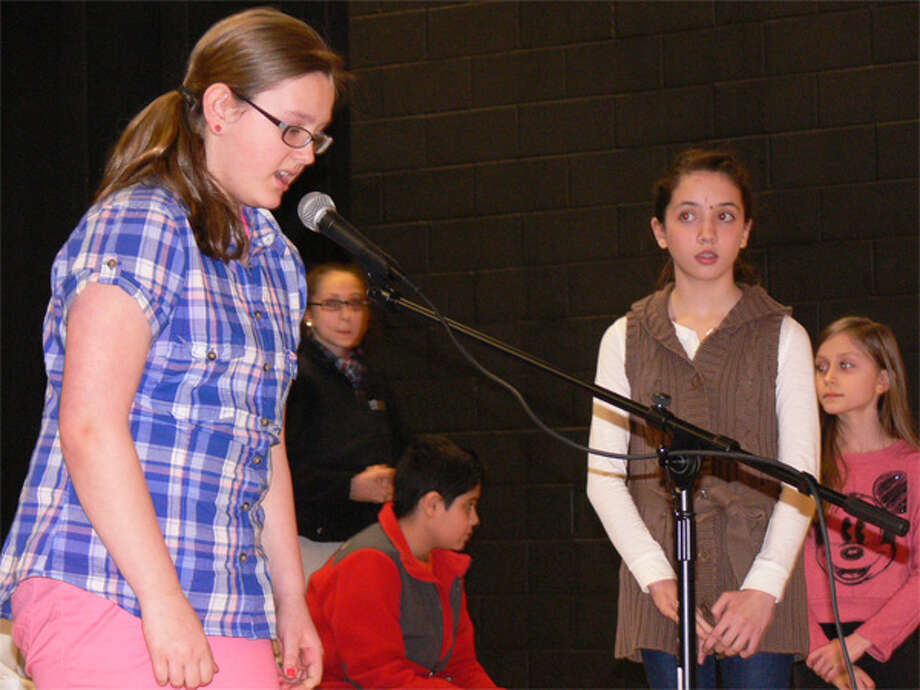 Kelsey Radzion, left, spells a word during the Perry Hill School spelling bee.