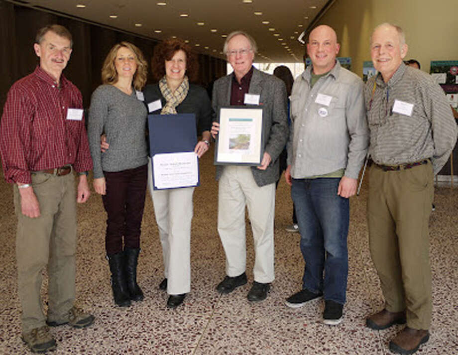 Accepting the 2013 Excellence in Conservation Award are Rich Skudlarek, Sandie Kopac, Sheri Dutkanicz, Bill Dyer, Joe Welsh and Bruce Nichols. This photo was taken by Teresa Gallagher, city conservation agent, who prepared and submitted the application that led to the statewide award.