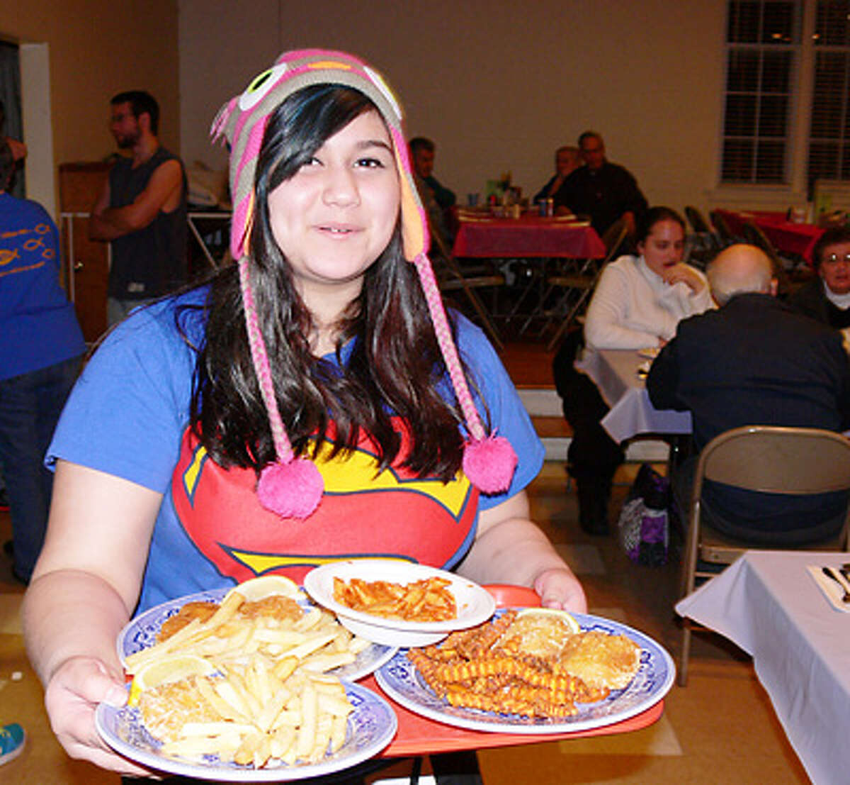 Ximenita Varas volunteers as a meal server during a past Lenten Fish Fry at United Methodist..