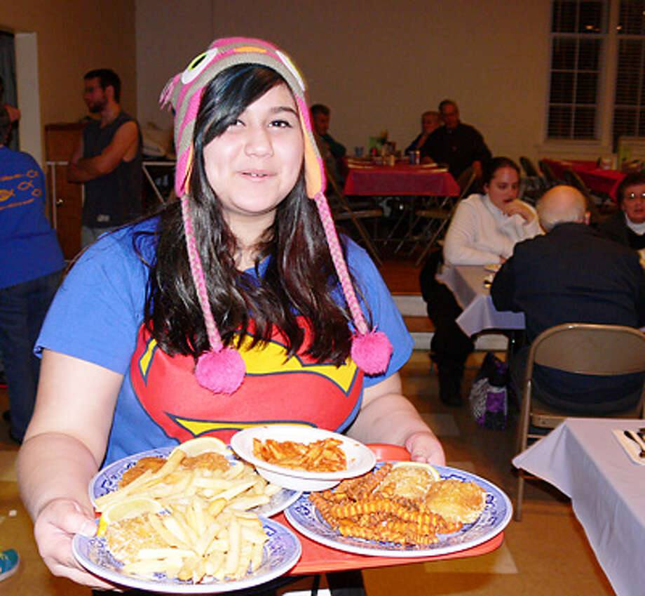 Ximenita Varas volunteers as a meal server during a past Lenten Fish Fry at United Methodist..