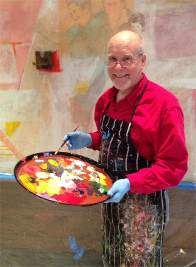 Artist and craftsman Tom Masaryk works on a contemporary mural for Il Palio's dining room in Shelton using images from executive chef Margherita Aloi's life story.