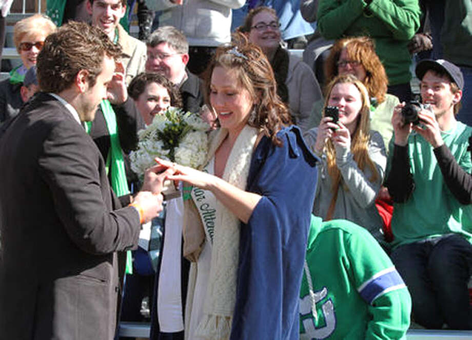 Dan Carr places an engagement ring on the finger of Kate Thompson of Shelton at the New Haven St. Patrick's Day parade.