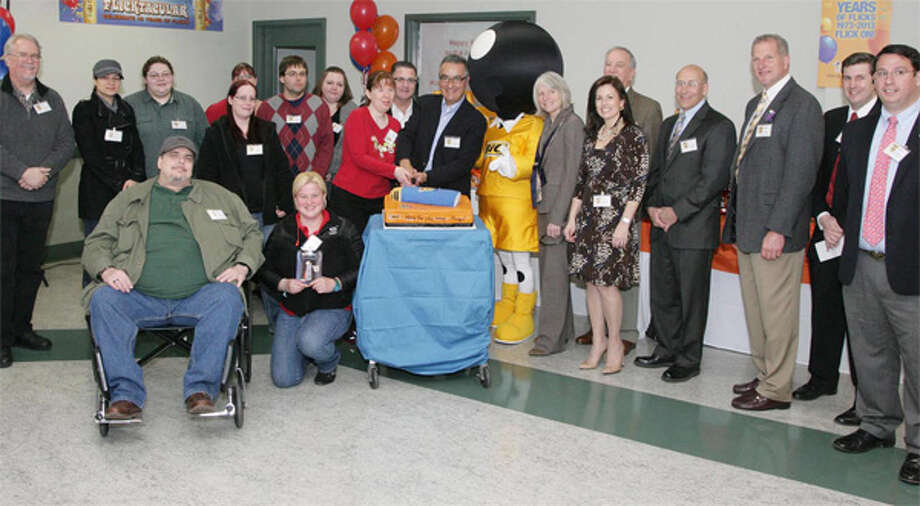The winners of the design-a-lighter contest at the Milford BIC factory with company officials and local dignitaries, including Shelton Mayor Mark Lauretti (third from right).