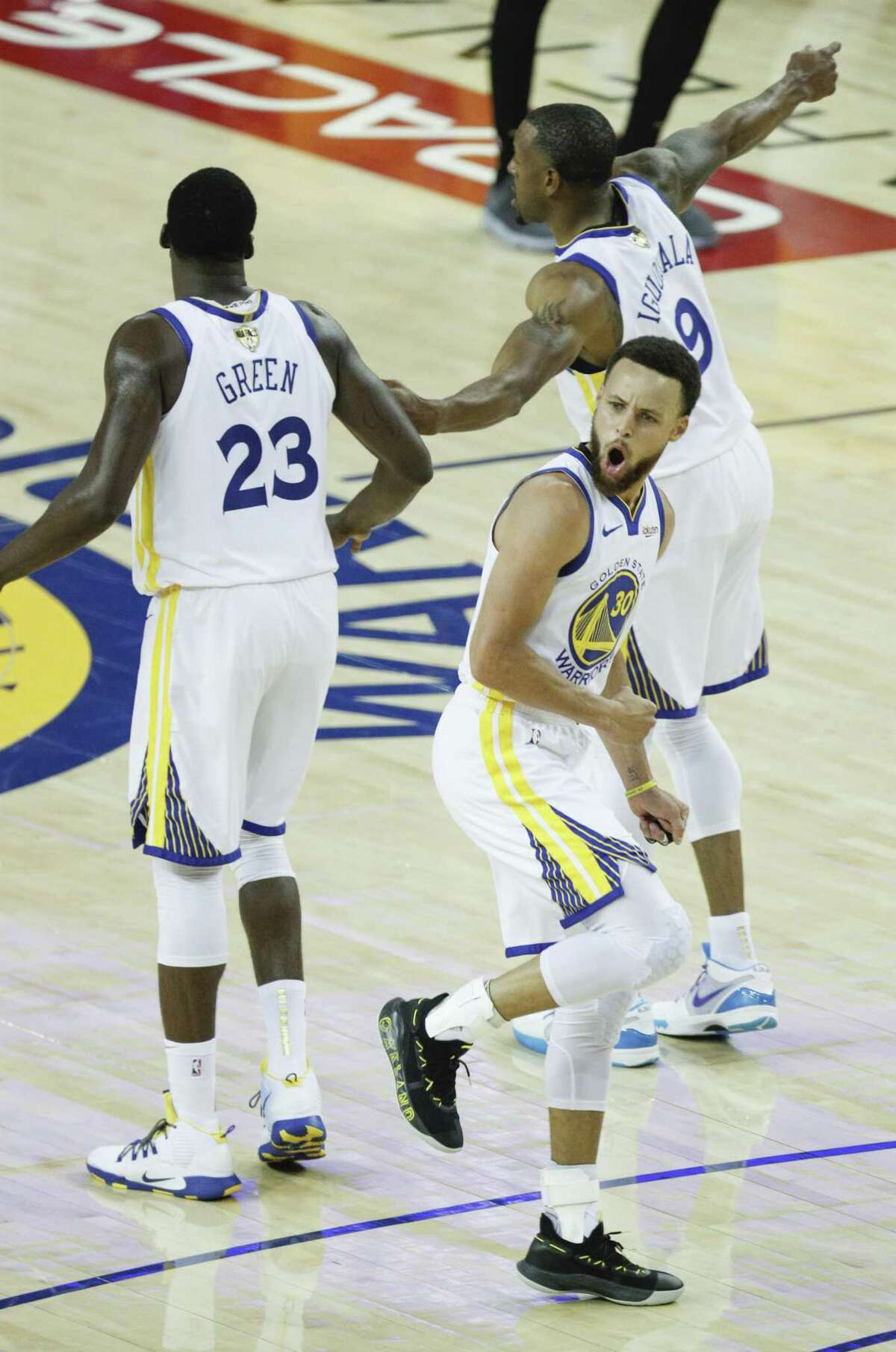 Golden State Warriors' Stephen Curry reacts after hitting a three-pointer in the second quarter during game 3 of the NBA Finals between the Golden State Warriors and the Toronto Raptors at Oracle Arena on Wednesday, June 5, 2019 in Oakland, Calif.