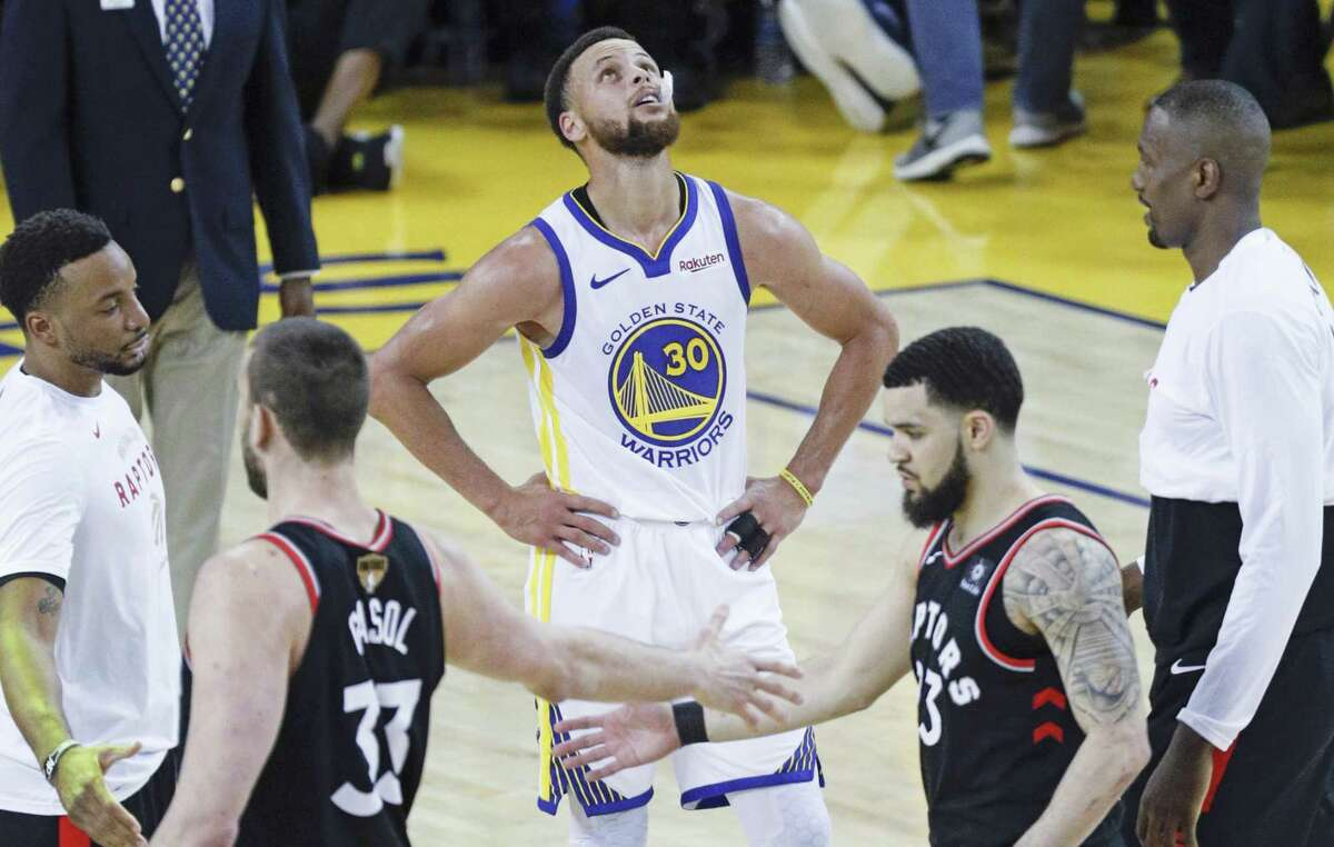 Golden State Warriors' Stephen Curry looks up at the scoreboard after their 123 to 109 defeat in game 3 of the NBA Finals between the Golden State Warriors and the Toronto Raptors at Oracle Arena on Wednesday, June 5, 2019 in Oakland, Calif.