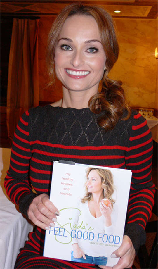 Television cooking personality and author Giada De Laurentiis with her new book while visiting Shelton.