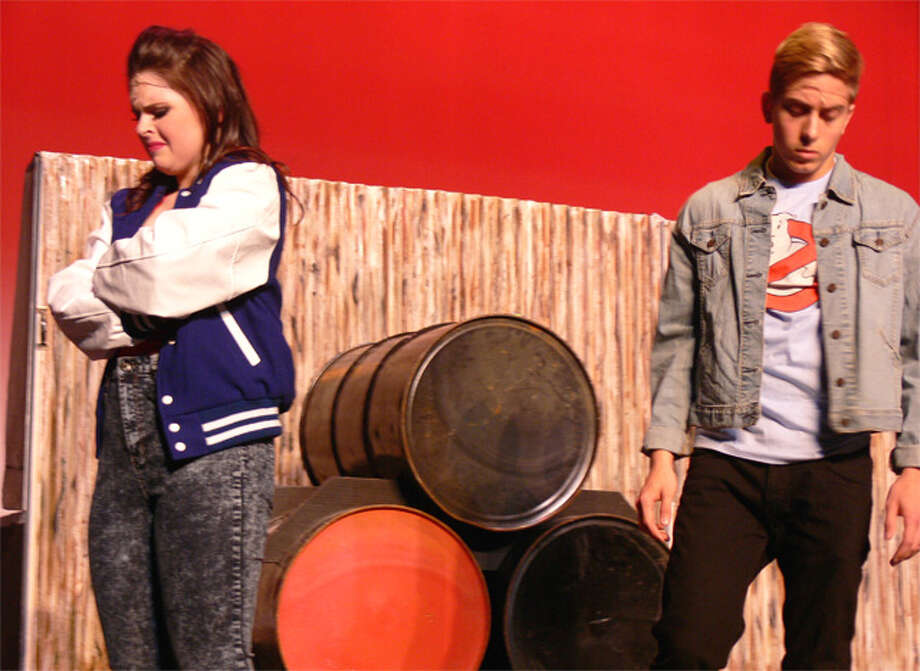 Shelton High senior Kathryn Twohill plays Ariel Moore and junior Gregory Wresilo is Ren McCormack in the SHS production.