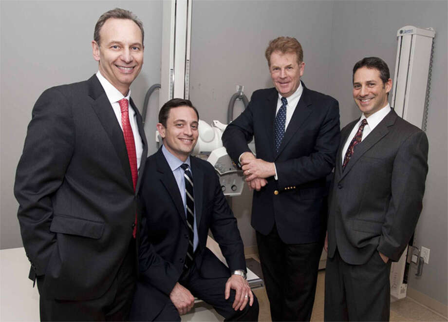 Shown, from left, are Dr. Tedd L. Weisman of OrthopedicHealth, Dr. Aaron K. Schachter of OrthopedicHealth, Glenn Elias, CEO of Connecticut Orthopaedic Specialists, and Dr. Amit Lahav of OrthopedicHealth.
