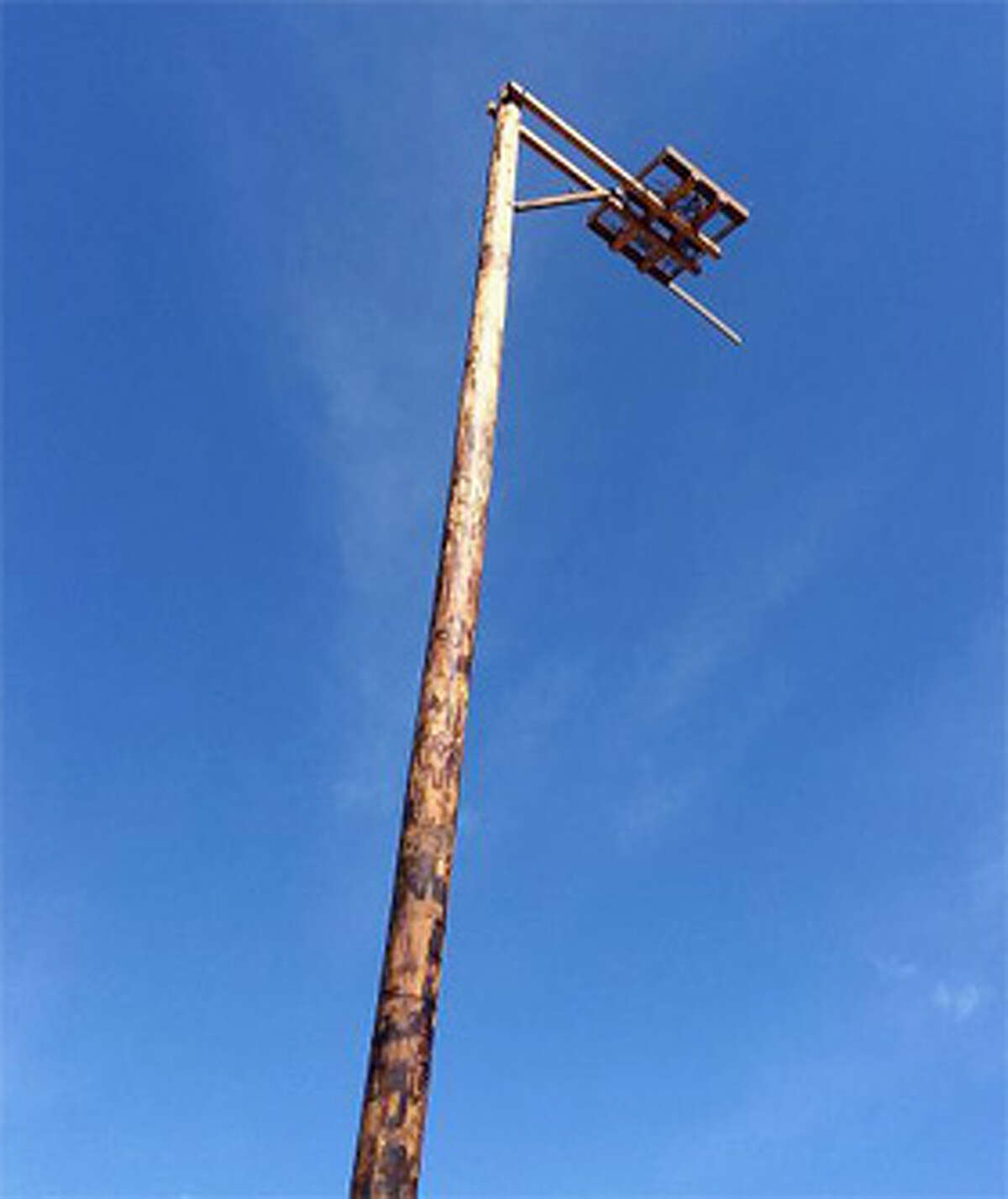 The osprey platform was installed on a 55-foot-tall pole that includes a 4-foot-long perch.