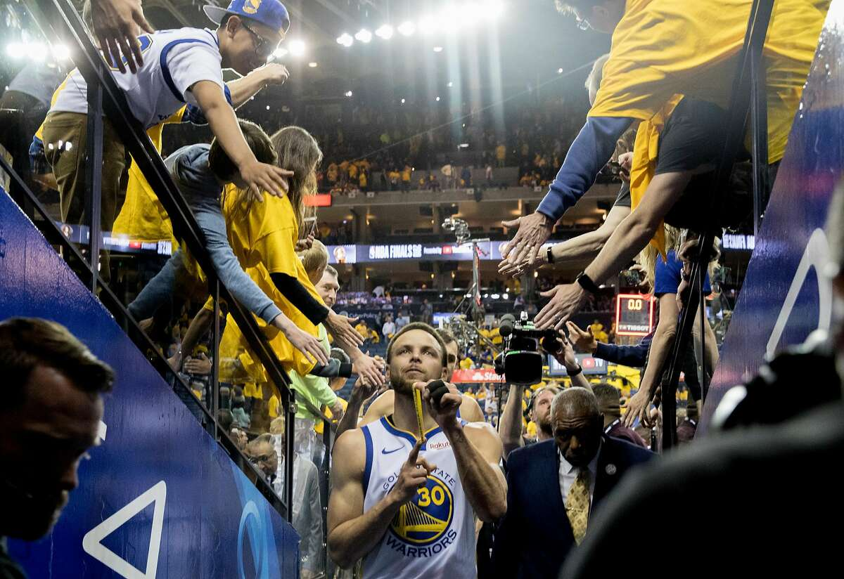 Warriors' Stephen Curry exits the court after the Golden State Warriors fell to the Toronto Raptors 123-109 in Game 3 of the NBA Finals at Oracle Arena in Oakland, Calif. Wednesday, June 5, 2019.