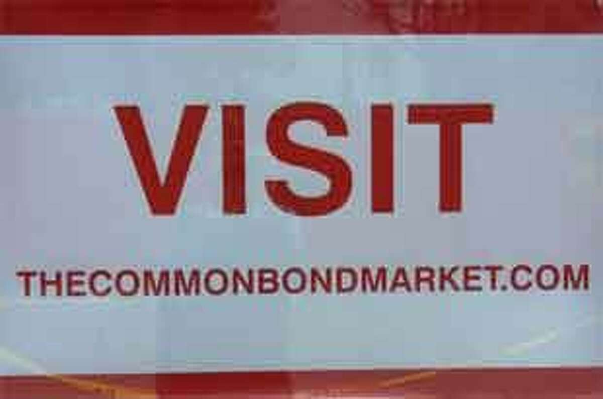This sign at the entrance invites people to check out the new store's website, thecommonbondmarket.com.