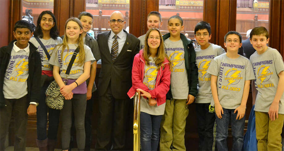 State Rep. Jason Perillo with the Perry Hill School Dominators robotics team outside the House chamber at the state Capitol.